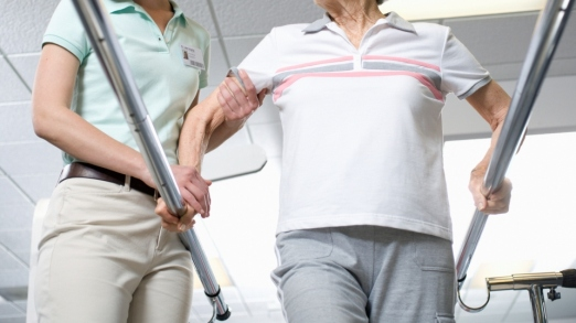 Physical Therapist Assisting Woman